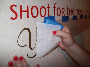 Rubbing the vinyl letters against the wall